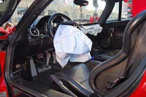 The deployed airbag of a totaled Enzo Ferrari. This rare car sells for up to $1 million, so imagine the cost of an airbag replacement!