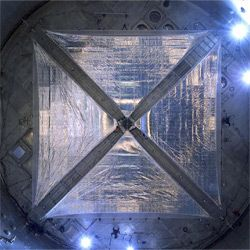 This four-quadrant solar sail system (66 feet on each side!) gets poked and prodded at NASA's Glenn Research Center at Plum Brook Station in 2005.