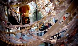 """Shoppers pass by the Anthropologie holiday display in Rockefeller Center on""""Black Friday"""" in New York City."""