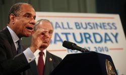 """American Express CEO Kenneth Chenault (left) and New York Mayor Michael Bloomberg announce """"Small Business Saturday"""" at City Hall, November 2010 in New York City."""