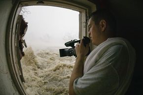 Professional storm photographer Mike Theiss documents Hurricane Katrina's record-setting storm surge from the emergency door of a beachfront hotel stairwell in Gulfport, Miss., on Aug. 29, 2005. See more storm pictures.