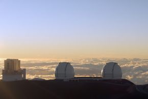The Subaru Telescope and the Twin Telescopes of the W. M. Keck Observatory peer at their surrounding from their perch above the clouds at Hawaii's Mauna Kea. Someday, we may install a telescope on the moon.