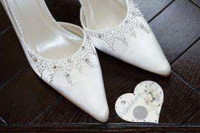 A coin in the bride's shoe may be intended to bring good fortune, but it may also lead to a sore foot.