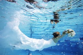 """Underwater shots are very popular in """"trashing the dress"""" photo sessions."""