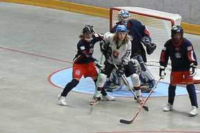 A game of street hockey can be a lot less formal than this, but it's still always a good idea to wear some protective gear.