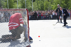 Prince William, Duke of Cambridge, takes a quick shot in a game of street hockey in Yellowknife, Canada.