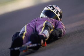 In a street luge competition, the only thing between your body and the road is the board. Wear proper safety gear.