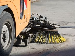 A mechanical street sweeper at work in Berlin, Germany.
