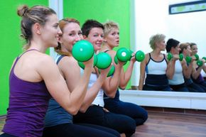 Strength training, like the bicep curls these women are doing, just twice a week can improve your health and fitness.