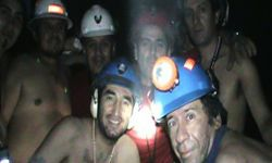 This television screenshot shows a group of miners trapped inside the San Jose mine in Copiapo, Chile in September 2010. The crew spent 70 days underground after the mine collapsed on Aug. 5.