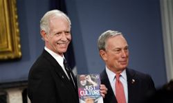 """Chesley """"Sully"""" Sullenberger poses with New York City mayor Michael Bloomberg in February 2009. Sullenberger safely guided a U.S. Airways flight into the Hudson River after it hit some birds just after takeoff."""