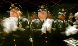 Port Authority officials applaud their comrades at a ceremony honoring those who acted heroically during the 9/11 terrorist attacks in New York City.