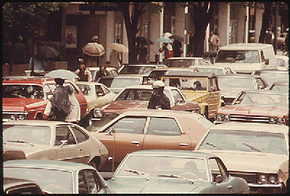 A policeman stands in the middle of a massive traffic jam during a 1974 bus drivers' strike in Washington, D.C.