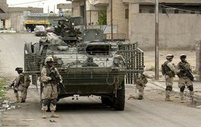 Soldiers dismount a Stryker Infantry Carrier Vehicle to conduct a patrol in Mosul, Iraq.
