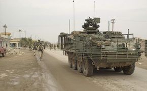 Stryker with slat armor Soldiers of the 2nd Infantry Division's Company B, 5th Battalion, 20th Infantry Regiment (Stryker Brigade Combat Team), conduct a patrol in Samarra, Iraq.