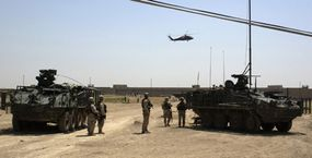 Soldiers maintain security for a helicopter landing zone just outside the city of Mosul, Iraq.