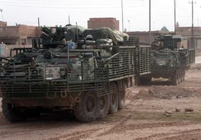 Stryker vehicles position themselves in the town of Samarra, a town northwest of Baghdad, Iraq, December 2003.
