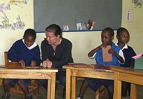 American Fulbright Fellow Angela Stone-MacDonald teaches children with disabilities at the Irente Rainbow School (IRS) in Lushoto, Tanzania.