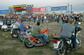 Bikers sit on their motorcycles as they wait for a concert to start at the Buffalo Chip Campground at the Sturgis Motorcycle Rally in Sturgis, S.D.
