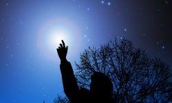 child pointing at stars