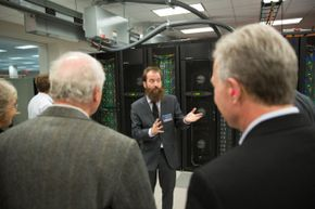 The director of the Texas Advanced Computing Center, Bill Barth, takes guests on a tour of Stampede.