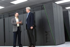 Fret Streitz and Doug East of the Livermore National Laboratory, standing in front of supercomputer Vulcan.