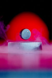 What you're seeing here is the Meissner effect, or the expulsion of a magnetic field from a superconductor as it transitions to its superconducting state.