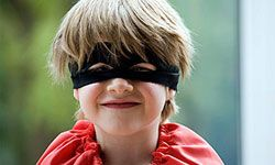 A mask and a cape are the key ingredients to any superhero's wardrobe.