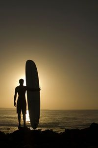 Tips for surfing safely include being familiar with the beach before you start surfing.