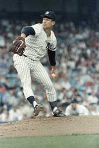 Tommy John pitches during a 1986 game at Yankee Stadium, more than a decade after his career-saving surgery.