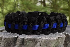 """The survival bracelet is generally made from woven paracord and can be 8 to 20 feet long. Use a string from its """"guts"""" to make a firestarter."""