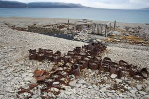 This memorial cross of empty tin cans, used as a post office to leave messages, dates to 1854 and the search for survivors of the ill-fated Sir John Franklin Expedition. It's located on Beechey Island in Nunavut, Canada.