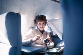 Looking surprisingly glamorous, Helen Klaben, one of the two who survived 49 days lost in the Canadian Yukon wilderness, is shown aboard the Pan Am jet that took her to Seattle after her rescue.
