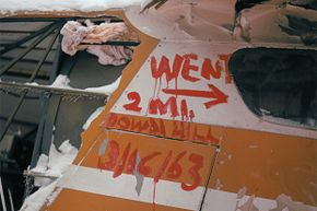 This distress sign was painted on the side of the plane that Helen Klaben and Ralph Flores went down in. They survived in the Arctic for more than 40 days without food.