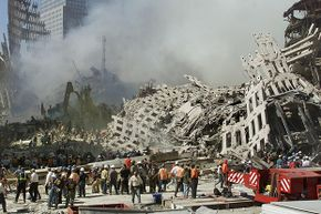 Rescue workers search for survivors as smoke rises from the rubble of the World Trade Center in New York, 2001. Genelle Guzman-McMillan was the last person pulled out alive.