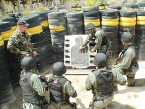 U.S. Army SWAT Team members review their actions after a training session.