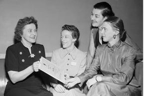 Dr. Maria Telkes (far left) received the first SWE merit award in 1951 for designing a distilling system using solar heat to convert sea water to drinking water. On the far right is Dr. Beatrice Hicks, the SWE's first president.