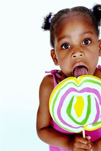 A child with a raging sweet tooth can't pass up a colorful lollipop. See more candy pictures.