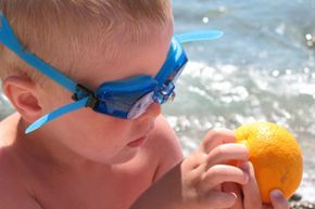 Swim goggles, check. A nice orange for a snack, check. See more beach pictures.