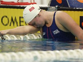 Victorious Australian swimmer Leisel Jones take a moment to get her breath after feeling the effects of the water's drag following a 2003 race.