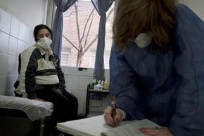 A pregnant woman with swine flu symptoms receiving medical treatment in Argentina.