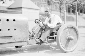 Image Gallery: Sports Cars Legendary race car driver Barney Oldfield preparing for a 1905 spin around the block. See pictures of sports cars.