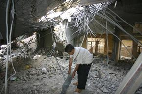 Three people died in this building after a U.S. air raid on what the military said was a suspected safe house for foreign fighters in the Iraqi rebel city of Fallujah.