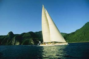 A large charter sailboat cruises in the Guadeloupe Islands. See more pictures of sailing.