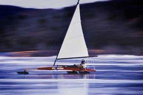 An ice boater zips across Ghost Lake, Alberta.