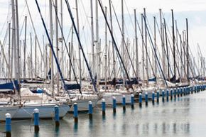 Sailing clubs usually offer fleets of small sailboats and are open to people who don't own their own boats.