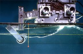 A lab test of Salter's Duck. The Duck is the tear-drop shaped object, many of which would be attached to a long spine undersea. In practice, the duck will not need the mounting above it. See more green science pictures.