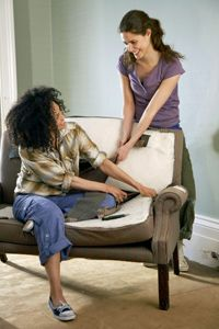 If reupholstering is the way to go, make it fun and invite some friends to come help you.