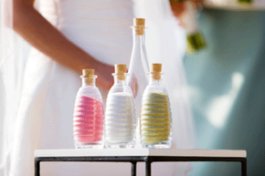 A sand ceremony offers a symbolic, visually poignant moment that can help personalize a wedding.