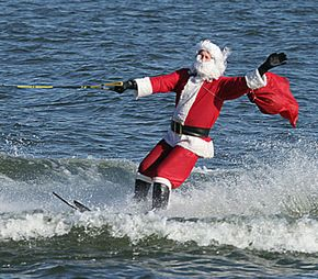 Santa waves as he water-skis on the Potomac River in Washington, D.C.